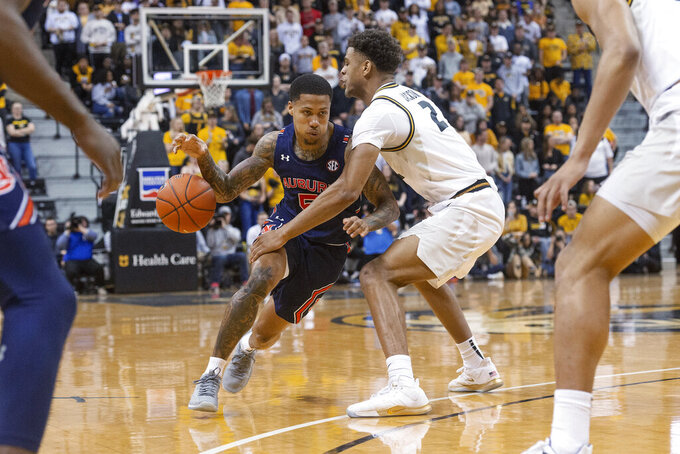 Missouri's Tray Jackson, right, knocks the ball away from Auburn's J'Von McCormick during the first half of an NCAA college basketball game Saturday, Feb. 15, 2020, in Columbia, Mo. Missouri won 85-73. (AP Photo/L.G. Patterson)