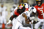 Howard running back Jarett Hunter (22) runs with the ball against Maryland defensive lineman Sam Okuayinonu (97) during the first half of an NCAA college football game, Saturday, Sept. 11, 2021, in College Park, Md. (AP Photo/Nick Wass)