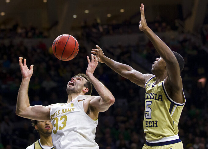 Notre Dame's John Mooney (33) competes for a rebound with Georgia Tech's James Banks III and Moses Wright (5) during the second half of an NCAA college basketball game Saturday, Feb. 1, 2020, in South Bend, Ind. Notre Dame won 72-80. (AP Photo/Robert Franklin)