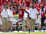 Georgia wide receiver Demetris Robertson (16) runs alone on the sidelines for a touchdown against Austin Peay during the first half of an NCAA college football game, Saturday, Sept. 1, 2018, in Athens, Ga. (AP Photo/Mike Stewart)