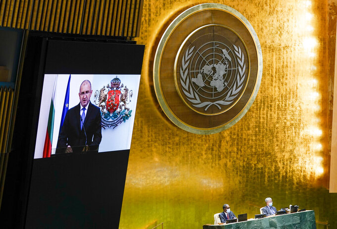 Bulgaria's President Rumen Radev is seen on a video screen as he addresses the 76th Session of the United Nations General Assembly remotely, Tuesday, Sept. 21, 2021 at U.N. headquarters. (AP Photo/Mary Altaffer, Pool)