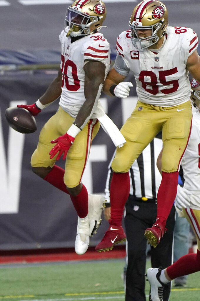 San Francisco 49ers running back Jeff Wilson Jr., left, celebrates his touchdown with George Kittle, right, in the first half of an NFL football game against the New England Patriots, Sunday, Oct. 25, 2020, in Foxborough, Mass. (AP Photo/Steven Senne)