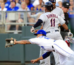 Cleveland Indians' Jose Ramirez (11) beats the throw to Kansas City Royals first baseman Cheslor Cuthbert (19) during the third inning of a baseball game at Kauffman Stadium in Kansas City, Mo., Tuesday, July 2, 2019. Ramirez was safe, but Jason Kipnis was out at second. (AP Photo/Orlin Wagner)