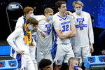 Creighton players watch the final moments of the second half of a college basketball game against UC Santa Barbara in the first round of the NCAA tournament at Lucas Oil Stadium in Indianapolis Saturday, March 20, 2021. Creighton won 63-62. (AP Photo/Mark Humphrey)