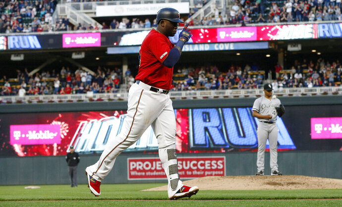 Minnesota Twins' Miguel Sano jogs home on a solo home run off Chicago White Sox pitcher Reynaldo Lopez, right, during the third inning of a baseball game Friday, May 24, 2019, in Minneapolis. (AP Photo/Jim Mone)