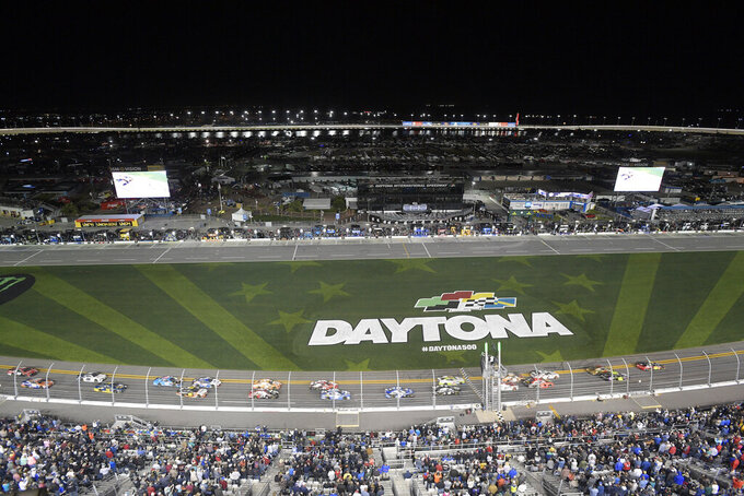 Drivers take the green flag on the start of the first of two qualifying races for the NASCAR Daytona 500 auto race at Daytona International Speedway Thursday, Feb. 14, 2019, in Daytona Beach, Fla. (AP Photo/Phelan M. Ebenhack)