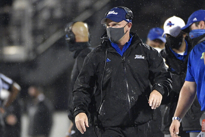 Tulsa coach Philip Montgomery watches from the sideline during the first half of the team's NCAA college football game against Central Florida, Saturday, Oct. 3, 2020, in Orlando, Fla. (AP Photo/Phelan M. Ebenhack)