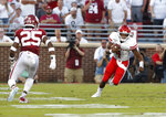 Houston quarterback D'Eriq King (4) runs the ball as Oklahoma safety Justin Broiles (25) closes in during the first half of an NCAA college football game in Norman, Okla., Sunday, Sept. 1, 2019. (AP Photo/Alonzo Adams)