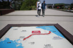 A map of two Koreas showing the Demilitarized Zone with North Korea's capital Pyongyang and South Korea's capital Seoul is seen at the Imjingak Pavilion in Paju, South Korea, Tuesday, June 9, 2020. North Korea said Tuesday it will cut off all communication channels with South Korea as it escalates its pressure on the South for failing to stop activists from floating anti-Pyongyang leaflets across their tense border. (AP Photo/Lee Jin-man)