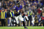 Baltimore Ravens quarterback Lamar Jackson (8) works out of the pocket against the Tennessee Titans during the first half an NFL divisional playoff football game, Saturday, Jan. 11, 2020, in Baltimore. (AP Photo/Gail Burton)