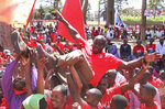 In this photo taken Wednesday, Sept. 11, 2019, a ruling Frelimo party supporters is tossed in the air at an election rally in Maputo, Mozambique. The country's elections on Tuesday, Oct 15, 2019 are almost certain to return the ruling party, Frelimo, and President Filipe Nyusi, to power but it is unclear if the results will establish badly needed stability and economic growth. (AP Photo/Ferhat Momade)
