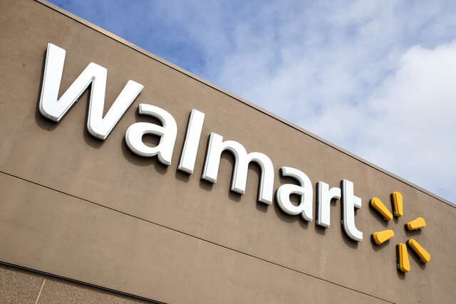 File- A Walmart in Warrington, Pa., is shown Tuesday, March 17, 2020. A couple in Minnesota wore red face masks emblazoned with swastikas to a Walmart in a video posted on social media. Police were called Saturday, July 25, 2020, to the Walmart in Marshall, Minn., in the southwest part of the state, on a report that two shoppers were wearing the mask with the symbol used by the Nazi Party. (AP Photo/Matt Rourke, File)