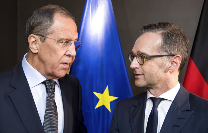 German foreign minister Heiko Maas, right, talks to Russian foreign minister Sergej Lawrow at a bilateral meeting at the Security Conference in Munich, Germany, Friday, Feb. 15, 2019.  (Sven Hoppe/dpa via AP)