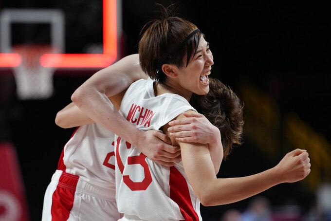 Japan's Saki Hayashi, left, and Japan's Rui Machida, right, celebrate the team's win over Belgium in a women's basketball quarterfinal game at the 2020 Summer Olympics, Wednesday, Aug. 4, 2021, in Saitama, Japan. (AP Photo/Eric Gay)