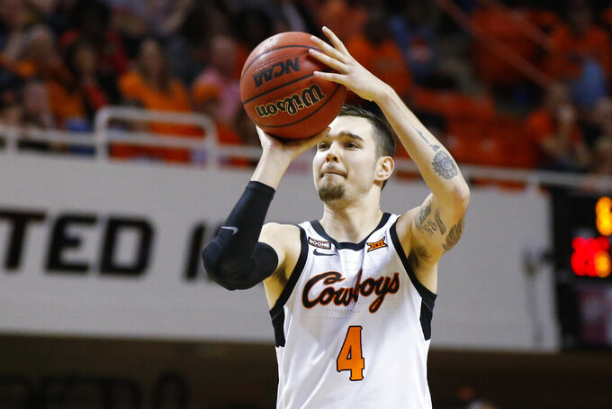 Oklahoma State guard Thomas Dziagwa (4) takes a three-point-shot in the first half of an NCAA college basketball game against Iowa State in Stillwater, Okla., Saturday, Feb. 29, 2020. (AP Photo/Sue Ogrocki)