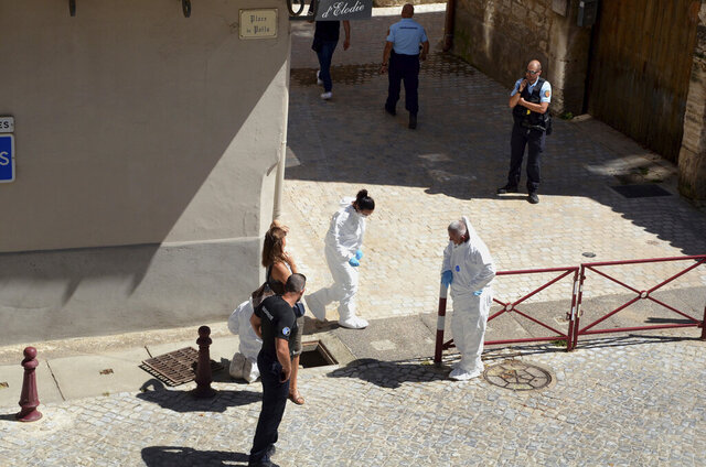 French police stand next a storm drain where the body of Laure Bardina-Kruger was found, in Peyriac de Mer, southern France, Friday, July 24, 2020. A French-American man from Brooklyn was in custody Sunday after he told police that he twice stabbed his wife whose body was found in a storm drain, a local newspaper reported. La Dépêche du Midi named the man as Billy Kruger and said he was detained Friday as he was preparing to fly from Toulouse. (AP Photo/Christophe Barreau)