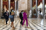 House Speaker Nancy Pelosi of Calif., right, walks to her office, Monday, Sept. 14, 2020, on Capitol Hill in Washington. (AP Photo/Jacquelyn Martin)