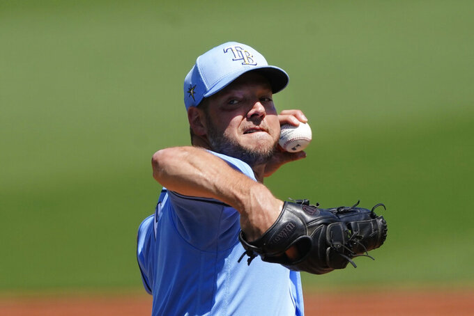Tampa Bay Rays starting pitcher Rich Hill (14) works in the first inning of a spring training baseball game against the Boston Red Sox, Friday, March 19, 2021, in Fort Myers, Fla.. (AP Photo/John Bazemore)