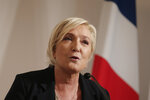 Far-right leader Marine le Pen speaks during a press conference on immigration Tuesday, Sept. 28, 2021 in Paris. Presidential candidate for the 2022 presidential election Marine Le Pen announced plans for an immigration referendum. (AP Photo/Lewis Joly)