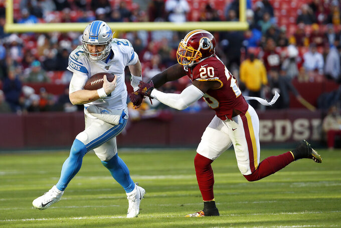 Detroit Lions quarterback Jeff Driskel (2) scrambles as Washington Redskins strong safety Landon Collins (20) tries to bring him down during the second half of an NFL football game, Sunday, Nov. 24, 2019, in Landover, Md. (AP Photo/Alex Brandon)