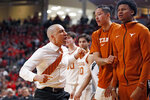Texas coach Shaka Smart celebrates with his team during the second half of an NCAA college basketball game against Texas Tech, Saturday, Feb. 29, 2020, in Lubbock, Texas. (AP Photo/Brad Tollefson)