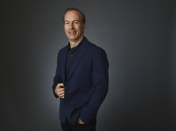 """FILE - In this Thursday, Jan. 16, 2020, file photo, Bob Odenkirk, star of the AMC drama series """"Better Call Saul,"""" poses for a portrait during the 2020 Winter Television Critics Association Press Tour, in Pasadena, Calif. Odenkirk is back shooting """"Better Call Saul,"""" six weeks after having a heart attack. Odenkirk on Wednesday, Sept. 8, 2021, tweeted a photo of himself getting made up to play title character Saul Goodman in the AMC series, indicating that shooting had resumed on its sixth and final season. (AP Photo/Chris Pizzello)"""