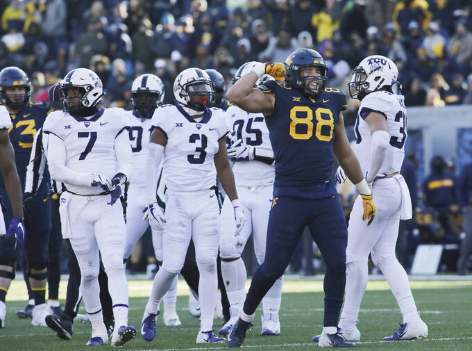 West Virginia tight end Trevon Wesco (88) celebrates after his reception during the second half of an NCAA college football game against TCU, Saturday, Nov. 10, 2018, in Morgantown, W.Va. (AP Photo/Raymond Thompson)