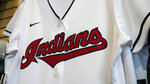 FILE - A Cleveland Indians jersey hangs at the Cleveland Indians team shop in Cleveland, in this Wednesday, Dec. 16, 2020, file photo. Known as the Indians since 1915, Cleveland's Major League Baseball team will be called Guardians. The ballclub announced the name change Friday, July 23, 2021, with a video on Twitter narrated by actor Tom Hanks, ending months of internal discussions triggered by a national reckoning by institutions and teams to permanently drop logos and names considered racist. (AP Photo/Tony Dejak, File)