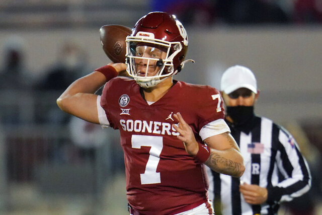 Oklahoma quarterback Spencer Rattler (7) throws a pass during the second half of the team's NCAA college football game against Baylor on Saturday, Dec. 5, 2020, in Norman, Okla. (AP Photo/Sue Ogrocki)