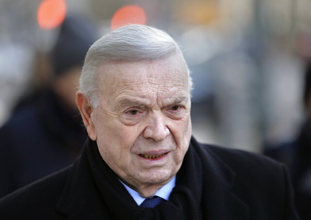 FILE - In this Dec. 13, 2017, file photo, Jose Maria Marin, of Brazil, arrives to federal court in the Brooklyn borough of New York. Marin, the former head of Brazilian soccer, was granted compassionate release from a U.S. federal prison on Monday, March 30, 2020, amid the new coronavirus pandemic, his sentence cut short by about eight months. Marin was sentenced to four years in prison in August 2018 for his participation in a scheme to accept bribes in exchange for the media and marketing rights to soccer tournaments. (AP Photo/Seth Wenig, Fle)