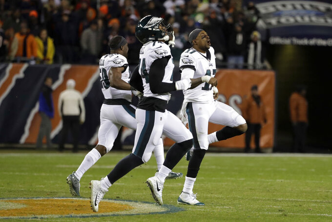 Philadelphia Eagles players celebrate after Chicago Bears kicker Cody Parkey misses a field goal during the second half of an NFL wild-card playoff football game Sunday, Jan. 6, 2019, in Chicago. The Eagles won 16-15. (AP Photo/Nam Y. Huh)
