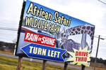 A sign directs traffic to the African Safari Wildlife Park on Friday, Nov. 29, 2019, where officials say at least 10 animals were killed Thursday in a barn fire at the wildlife park in Port Clinton, Ohio. Three bongos, three giraffes, three red river hogs and a springbok housed in the barn were thought to be dead, fire officials said. The cause of the fire is under investigation. No humans were injured.(AP Photo/David Richard)