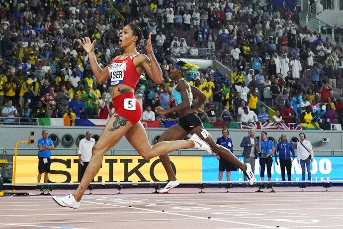 Salwa Eid Naser, of Bahrain, wins ahead of Shaunae Miller-Uibo, of Bahamas, in the women's 400 meter final at the World Athletics Championships in Doha, Qatar, Thursday, Oct. 3, 2019. (AP Photo/David J. Phillip)