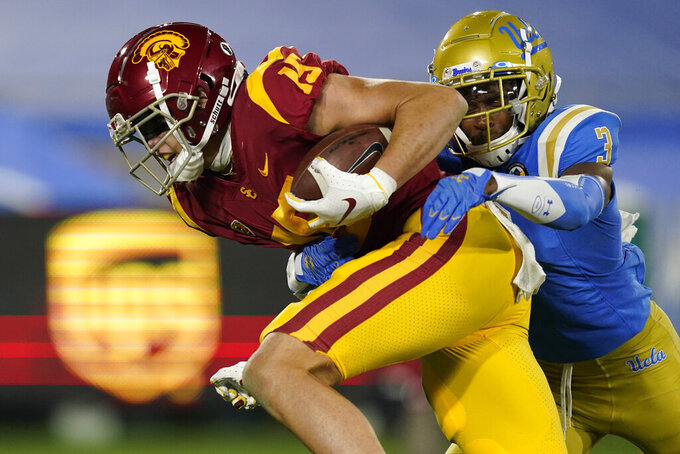 Southern California wide receiver Drake London, left, runs to the end zone for a touchdown while being tackled by UCLA defensive back Rayshad Williams during the second quarter of an NCAA college football game Saturday, Dec 12, 2020, in Pasadena, Calif. (AP Photo/Ashley Landis)