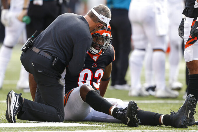 Cincinnati Bengals defensive tackle Andrew Brown (93) sits on the field with an apparent injury in the second half of an NFL football game against the Jacksonville Jaguars, Sunday, Oct. 20, 2019, in Cincinnati. (AP Photo/Gary Landers)