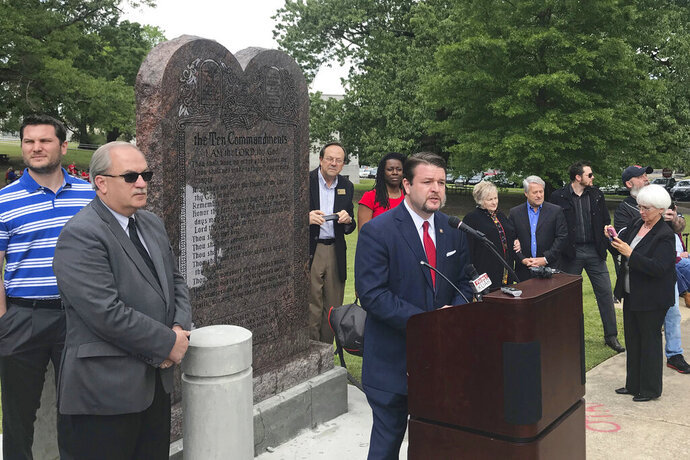 FILE - In this April 26, 2018, file photo, Arkansas Republican state Sen. Jason Rapert speaks at the unveiling of a Ten Commandments monument outside the Arkansas state Capitol in Little Rock. An attorney for Rapert on Wednesday, Sept. 11, 2019, asked a federal judge to issue an order limiting the use of any deposition video in the lawsuit challenging the display's constitutionality.(AP Photo/Andrew DeMillo, File)