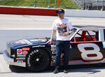 """FILE - Dale Earnhardt Jr. stands by the car he will drive in pre-race activities before the NASCAR Xfinity Series auto race at Darlington Raceway in Darlington, S.C., in this Saturday, May 8, 2021, file photo. The car is a Chevy Nova that his father drove in what is now the Xfinity Series. JR Motorsports has had initial conversations about taking its team to NASCAR's top level, a step up to Cup that would be much smoother if it could get its hands on a charter. """"I heard $10 million, is that what you heard?"""" JRM co-owner Dale Earnhardt Jr. told The Associated Press. """"I'm not paying that.""""(AP Photo/Terry Renna, File)"""