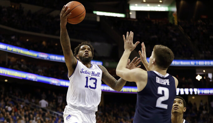 Seton Hall guard Myles Powell (13) goes up for a layup against Villanova guard Collin Gillespie (2) and forward Jermaine Samuels, lower right, during the second half of an NCAA college basketball game, Saturday, March 9, 2019, in Newark, N.J. Seton Hall defeated Villanova 79-75. (AP Photo/Kathy Willens)