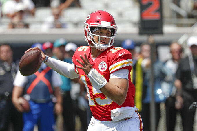 Kansas City Chiefs quarterback Patrick Mahomes throws a pass during the first half of an NFL football game against the Jacksonville Jaguars, Sunday, Sept. 8, 2019, in Jacksonville, Fla. (AP Photo/John Raoux)