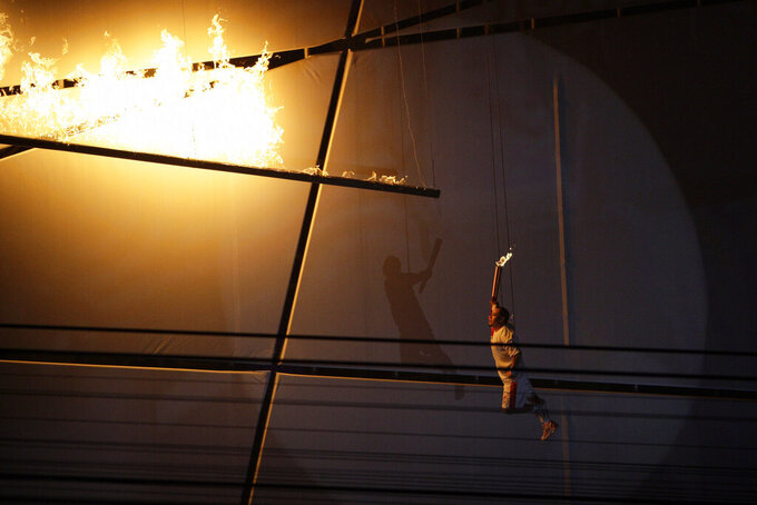 Li Ning lights the Olympic Torch during the opening ceremony for the Beijing 2008 Olympics in Beijing, Friday, Aug. 8, 2008. (AP Photo/Julie Jacobson)