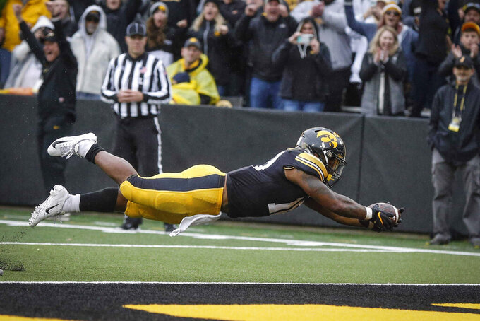 Iowa junior running back Mekhi Sargent dives into the end zone for a touchdown in the fourth quarter of an NCAA college football game against Purdue, Saturday, Oct. 19, 2019, at Kinnick Stadium in Iowa City, Iowa. (Bryon Houlgrave/The Des Moines Register via AP)