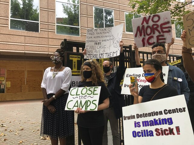 FILE - In this Tuesday, Sept. 15, 2020, file photo, Dawn Wooten, left, a nurse at Irwin County Detention Center in Ocilla, Georgia, speaks at a news conference in Atlanta protesting conditions at the immigration jail. The Trump administration is deporting several women who have alleged they were abused or mistreated by a Georgia gynecologist at an immigration detention center, according to lawyers representing the women. (AP Photo/Jeff Amy, File)
