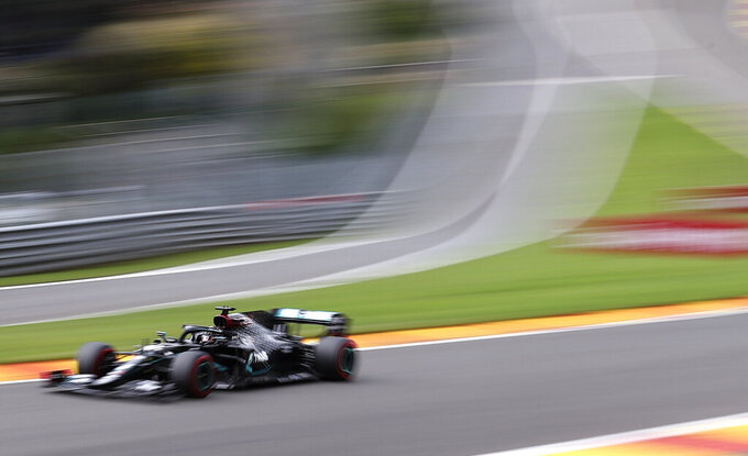 Mercedes driver Lewis Hamilton of Britain steers his car during the qualifying session prior to the Formula One Grand Prix at the Spa-Francorchamps racetrack in Spa, Belgium Saturday, Aug. 29, 2020. (Lars Baron, Pool via AP)