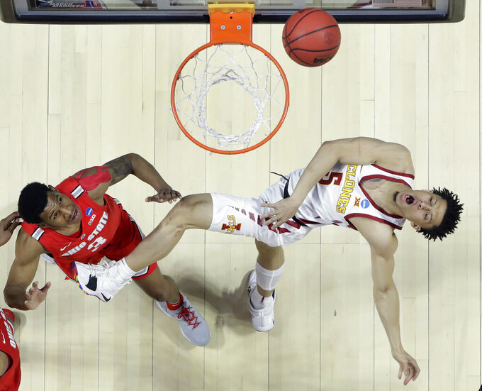Iowa State's Lindell Wigginton, right, throws up a shot as Ohio State's C.J. Jackson watches during the second half of a first round men's college basketball game in the NCAA Tournament Friday, March 22, 2019, in Tulsa, Okla. Ohio State won 62-59. (AP Photo/Jeff Roberson)