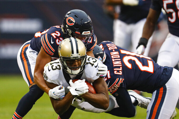 New Orleans Saints wide receiver Michael Thomas (13) its tackled by Chicago Bears strong safety Ha Ha Clinton-Dix (21) and cornerback Kyle Fuller (23) during the first half of an NFL football game in Chicago, Sunday, Oct. 20, 2019. (AP Photo/Charles Rex Arbogast)