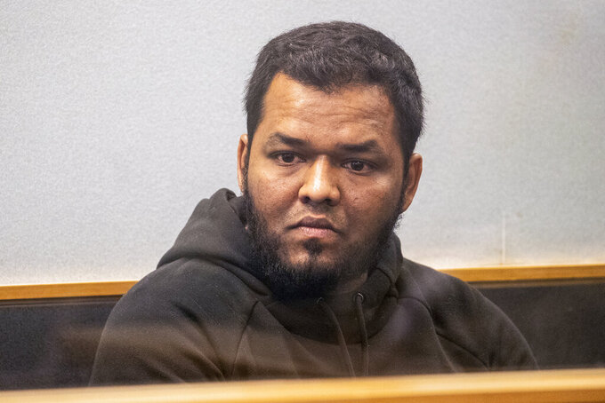"""Ahamed Aathil Samsudeen appears in the High Court in Auckland, New Zealand, on Aug. 7, 2018, after he was found possessing a series of images which depict extreme violence, cruelty, death and graphic war scenes. Samsudeen grabbed a kitchen knife from a store shelf and begins stabbing shoppers while chanting """"Allahu akbar"""" — meaning """"God is great"""" at a Countdown supermarket on Sept. 3, 2021 New Zealand feared the extremist but found no way to stop him. (Greg Bowker/New Zealand Herald via AP)"""