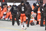 Cleveland Browns quarterback Baker Mayfield (6) walks on the sidelines during an NFL football game against the Las Vegas Raiders, Sunday, Nov. 1, 2020, in Cleveland. The Raiders won 16-6. The Cleveland Browns have placed quarterback Baker Mayfield on the Reserve/COVID-19 list after a staff member tested positive for the virus. The team, which is on a bye this week, released a statement Sunday, Nov. 8 saying it was notified on Saturday of the positive test. Mayfield is believed to have had close contact with the unidentified infected person. (AP Photo/David Richard)