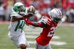 Ohio State defensive back Denzel Burke, right, breaks up a pass intended for Oregon receiver Kris Hutson during the first half of an NCAA college football game Saturday, Sept. 11, 2021, in Columbus, Ohio. (AP Photo/Jay LaPrete)