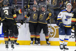 Vegas Golden Knights center Chandler Stephenson, center left, celebrates after right wing Reilly Smith, center right, scored against the St. Louis Blues during the third period of an NHL hockey game Saturday, Jan. 4, 2020, in Las Vegas. (AP Photo/John Locher)