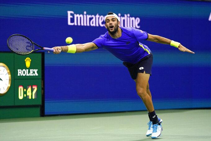 Matteo Berrettini, of Italy, returns against Novak Djokovic, of Serbia, during the quarterfinals of the U.S. Open tennis tournament, Wednesday, Sept. 8, 2021, in New York. (AP Photo/Frank Franklin II)